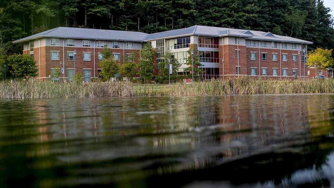 Residence hall exterior by lake